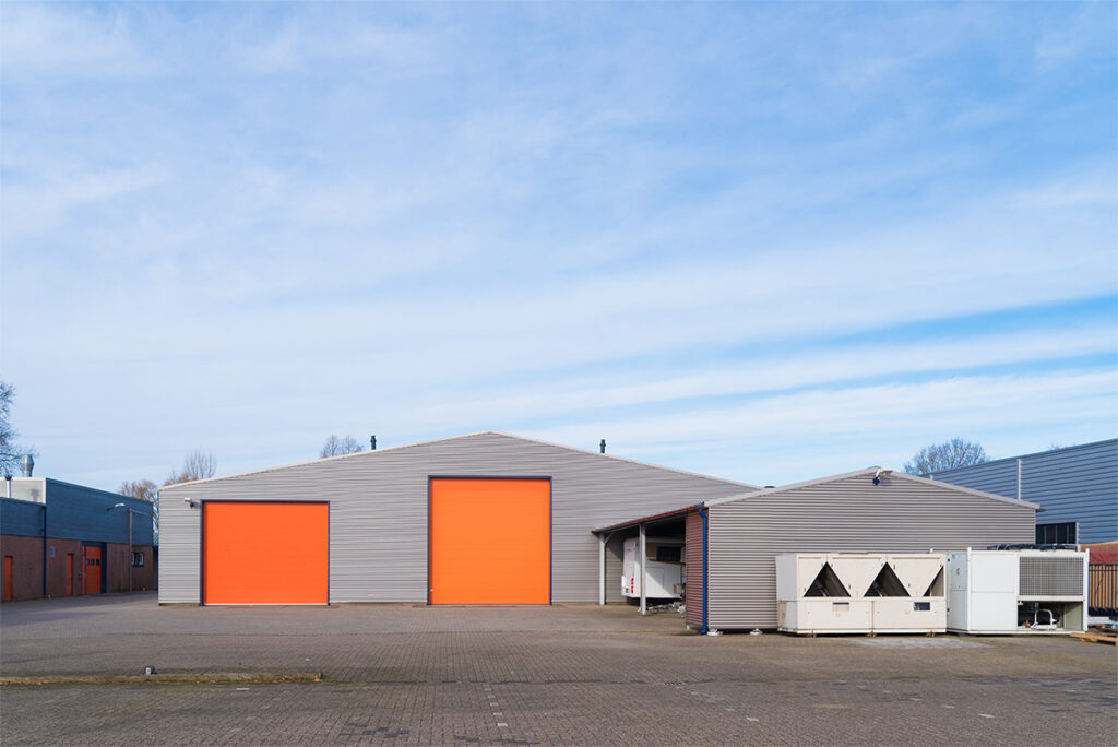 small industrial warehouse with orange roller doors